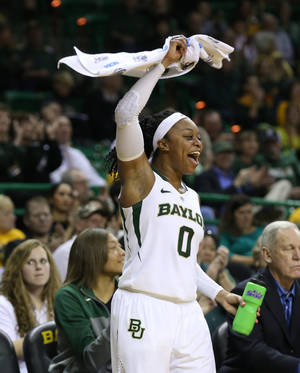 Photo - Baylor guard Odyssey Sims (0) celebrates a basket against Iowa State in the second half of an NCAA college basketball game, Wednesday, Feb. 19, 2014, in Waco, Texas. (AP Photo/Rod Aydelotte)