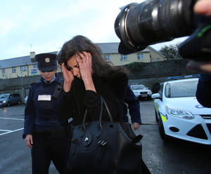 Photo - Jenny Lauren, centre, Niece of fashion designer Ralph Lauren, arrives at  Killaloe District Court, in Killaloe, Ireland, Tuesday, Jan. 7, 2014. The niece of fashion designer Ralph Lauren has appeared in an Irish court on charges of being drunk and disorderly on a New York-bound plane. Jewelry designer Jenny Lauren was arrested after a Delta flight from Barcelona made an unscheduled stop at Shannon Airport on Monday.  (AP Photo/PA, Niall Carson) UNITED KINGDOM OUT