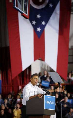 Photo -   President Barack Obama speaks to supporters during a campaign event at Mentor High School, Saturday, Nov. 3, 2012, in Mentor, Ohio. (AP Photo/Pablo Martinez Monsivais)