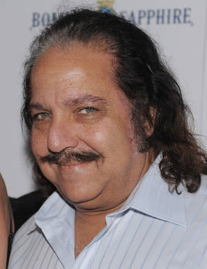 "photo - Adult film star Ron Jeremy attends a Cinema Society screening of ""Ghost Town"" at the IFC Center Monday, Sept. 15, 2008 in New York. Jeremy is recovering from surgery at a Los Angeles hospital after an aneurysm near his heart sent him to intensive care. Agent Mike Esterman says in an email to The Associated Press that he and others were waiting for Jeremy to awake Wednesday night Jan. 30, 2013 after a smooth procedure at Cedars-Sinai Medical Center. (AP Photo/Evan Agostini)"