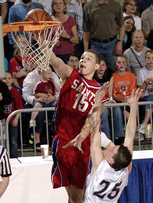 Photo - Oklahoma Christian's Blake Griffin (15) scores  against Sequoyah-Tahlequah's Heath Horawa (25) in the first quarter of the OSSAA Class 3A State Championship finals at the State Fair Arena, in Oklahoma City, Saturday, March 12, 2005.  By Bill Waugh/The Oklahoman
