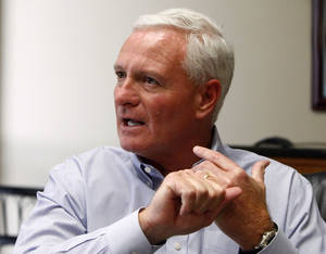 "Photo - FILE  - In this April 19, 2013, file photo, Cleveland Browns owner Jimmy Haslam  speaks in Knoxville, Tenn. Amid mounting criticism of Cleveland's coaching search, Haslam says in a letter to fans he's ""committed to finding the right leader for our team."" (AP Photo/Wade Payne, File)"