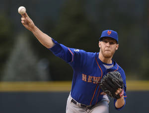 Photo - New York Mets starting pitcher Zack Wheeler (45) throws to the plate against the Colorado Rockies during the first inning of a baseball game, Friday, May 2, 2014, in Denver. (AP Photo/Jack Dempsey)