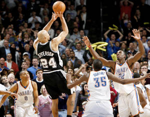 Photo - San Antonio's Richard Jefferson shoots the game-winning basket over Oklahoma City's Russell Westbrook, left, Kevin Durant, and Jeff Green during Wednesday's gamea at the Ford Center. Photo by Bryan Terry, The Oklahoman