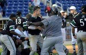 Photo - Arlington Country Day coach Ron Dickerson holds back an unidentifed Apaches player during the brawl Thursday at the Tate Aggie Classic. / Ben Twingley/Pensacola News Journal