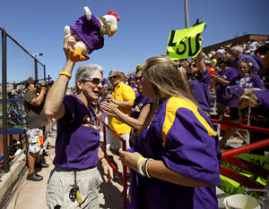Photo - LOUISIANA STATE UNIVERSITY / COLLEGE SOFTBALL: LSU fan Beazie Maurin leads a cheer during a Women's College World Series game at ASA Hall of Fame Stadium in Oklahoma City, Thursday, May 31, 2012.  Photo by Bryan Terry, The Oklahoman