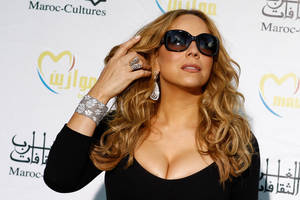 """Photo -   In this May 25, 2012 file photo, singer Mariah Carey poses before a press conference, during the Mawazine Festival in Rabat, Morocco. Mariah Carey, Usher and Celine Dion are among the heady names being tossed around as """"American Idol"""" replacement judges after the exits of judges Steven Tyler and Jennifer Lopez. (AP Photo/Abdeljalil Bounhar, File)"""