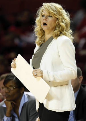 Photo - OU head coach Sherri Coale gives instructions to her team during a women's college basketball game between the Oklahoma Sooners and Texas Tech at Lloyd Noble Center in Norman, Okla., Monday, March 3, 2014. OU won 87-32. Photo by Nate Billings, The Oklahoman