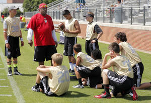 Photo - Charles Thompson talks to a group of quarterbacks during Football University at Casady High School in Oklahoma City, Saturday, June 21,  2014. Photo by Sarah Phipps, The Oklahoman