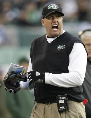 Photo - New York Jets head coach Rex Ryan reacts during the second half of an NFL football game against the San Diego Chargers, Sunday, Dec. 23, 2012, in East Rutherford, N.J. (AP Photo/Kathy Willens)