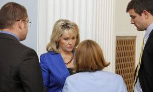 Photo - Gov. Mary Fallin talks over the Supreme Court health care ruling with members of her staff before meeting with the press at the state Capitol in Oklahoma City Thursday, June 28, 2012. The Supreme Court on Thursday upheld the individual insurance requirement at the heart of President Barack Obama's historic health care overhaul. Gov. Fallin was disappointed with the Supreme Court's ruling. Photo by Paul B. Southerland, The Oklahoman