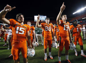 Photo -   Miami players sing their alma mater as they celebrate their 40-9 win over South Florida in an NCCA college football game, Saturday, Nov. 17, 2012 in Miami. (AP Photo/Wilfredo Lee)