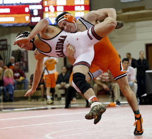 Photo - Oklahoma's Cody Brewer takes on Oklahoma State's Jon Morrison at 133 pounds during the 2014 Big 12 Wrestling Championship finals at the University of Oklahoma in McCasland Field House on March 8, 2014 in Norman, Okla. Photo by Steve Sisney, The Oklahoman