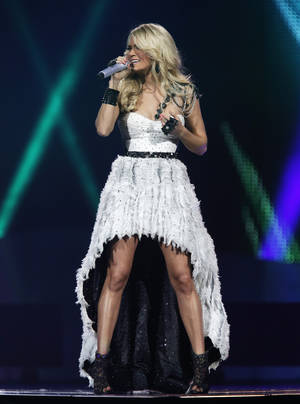 Photo - Carrie Underwood performs at the Chesapeake Energy Arena in Oklahoma City, Thursday, Oct. 25, 2012.  Photo by Garett Fisbeck, The Oklahoman
