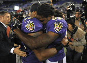 Photo -   Baltimore Ravens linebacker Ray Lewis, left, hugs wide receiver Torrey Smith after an NFL football game against the New England Patriots in Baltimore, Monday, Sept. 24, 2012. Baltimore won 31-30. Smith, who was playing less than 24 hours after the death of his 19-year-old brother, had six catches for 127 yards and two touchdowns for the Ravens. (AP Photo/Gail Burton)