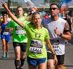 Photo -   In this photo provided by the Competitor Group, Sheryl Crow runs in the half marathon in Nashville on Saturday, April 28, 2012. (AP Photo/Competitor Group, Lester Cacho)
