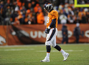 photo - Denver Broncos quarterback Peyton Manning  walks off the field against the Baltimore Ravens in the fourth quarter of an AFC divisional playoff NFL football game, Saturday, Jan. 12, 2013, in Denver. (AP Photo/Jack Dempsey)
