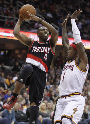 photo - Portland Trail Blazers' Nolan Smith (4) shoots over Cleveland Cavaliers' Daniel Gibson (1) in the first quarter of an NBA basketball game Saturday, Dec. 1, 2012, in Cleveland. (AP Photo/Tony Dejak)