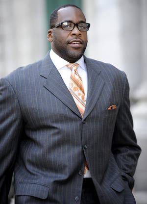 "Photo - FILE - In this Sept. 27, 2012 file photo, former Detroit mayor Kwame Kilpatrick makes his way to U.S. Federal Court in Detroit. Businessman Karl Kado, who held contracts at Detroit's convention center, said Monday, Dec. 3, 2012 that he was a ""hostage"" who felt compelled to pay thousands of dollars to then-Mayor Kwame Kilpatrick and his father or lose work. Kado told jurors that he personally delivered $5,000 to $10,000 to Kilpatrick ""three or four times."" He said he also delivered money through a top mayoral aide and separately paid $200,000 to $300,000 to Kilpatrick's father, Bernard. Kado is a crucial witness at the corruption trial, which began in September. (AP Photo/The Detroit News, David Coates)"