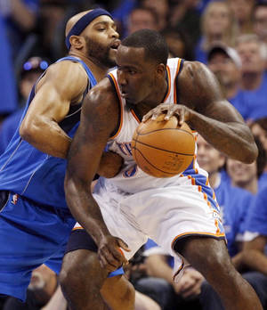 photo - Oklahoma City's Kendrick Perkins (5) works the ball against Dallas' Vince Carter (25) during game one of the first round in the NBA playoffs between the Oklahoma City Thunder and the Dallas Mavericks at Chesapeake Energy Arena in Oklahoma City, Saturday, April 28, 2012. Photo by Nate Billings, The Oklahoman