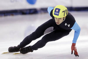 Photo - J.R. Celski competes in the men's 1,000 meters timetrial during the U.S. Olympic speedskating trials Thursday, Jan. 2, 2014, in Kearns, Utah. (AP Photo/Rick Bowmer)
