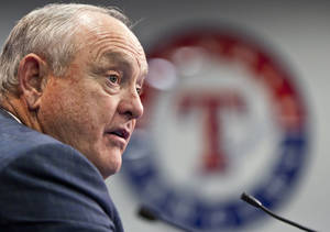 photo - FILE - In this Jan. 19, 2012, file photo, Texas Rangers president Nolan Ryan speaks to reporters in Arlington, Texas. Speculation has been growing about Ryan since some seemingly routine promotions announced last week. General manager Jon Daniels and chief operating officer Rick George were given new presidential titles by Rangers ownership. Friday's announcement included a statement from Ryan, who said he was proud of what the organization has accomplished in recent years. But he has made no other public comments since the moves, raising speculation whether his role is diminished. (AP Photo/Brandon Wade, File)