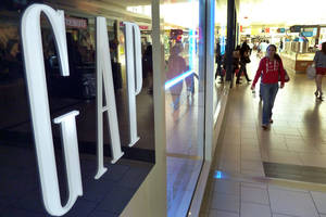 Photo -   In this May 14, 2012 photo, shoppers walk by the GAP store at a shopping mall in Peabody, Mass. Gap Inc. announced Thursday, Nov. 15, 2012, it is raising its outlook for the year after its third-quarter net income rose 60 percent from a year ago. (AP Photo/Elise Amendola, File)