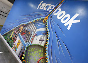 Photo - This Feb. 8, 2012 photo shows a mural at Facebook headquarters in Menlo Park, Calif. Intruders recently infiltrated the systems running the world's largest online social network but did not steal any sensitive information about Facebook's more than 1 billion users, according to a blog posting Friday, Feb. 15, 2013, by the company's security team. (AP Photo/Paul Sakuma)