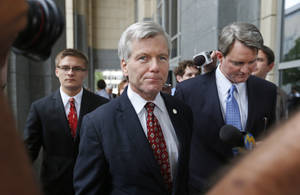 Photo - Former Virginia Gov. Bob McDonnell leaves the federal courthouse in Richmond, Va., with his lawyer John L. Brownlee on the second day of his and his wife Maureen's corruption trial, Tuesday, July 29, 2014. (AP Photo/Richmond Times-Dispatch, Alexa Welch Edlund)