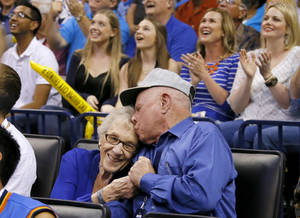 Photo -  Dale and Lois Higgins appear on the Kiss Cam during a timeout in the April 11 game between the Oklahoma City Thunder and the New Orleans Pelicans at Chesapeake Energy Arena. Oklahoma City won 116-94. Photo by Bryan Terry, The Oklahoman  <strong>BRYAN TERRY -   </strong>