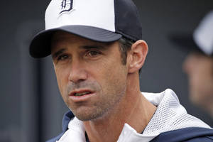 Photo - FILE - In this Feb. 27, 2014 file photo, Detroit Tigers' Brad Ausmus stands on the field before an exhibition spring training baseball game against the Atlanta Braves in Lakeland, Fla.  The contrasts are obvious just from looking at new Tigers manager Ausmus. He's going to be a slightly different type of presence than Jim Leyland in the Detroit clubhouse _ and he's already hoping to change Detroit's approach a bit to fit his style. (AP Photo/Gene J. Puskar, File)