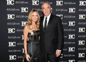 Photo - FILE - This Oct. 28, 2013 file photo shows Twentieth Century Fox Television chairmen and CEOs Dana Walden, left, and Gary Newman at the 23rd Annual Broadcasting & Cable Hall of Fame Awards in New York. Fox says that Gary Newman and Dana Walden, the two executives who run the company's television studio, will also be in charge of the Fox broadcast network. The appointment announced Monday, July 14, 2014, aligning 20th Century Fox Television with the network brings back a structure Fox had for five years ending a decade ago. (Photo by Evan Agostini/Invision/AP, File)