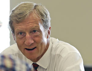 Photo - FILE - In this Sept. 25, 2013, file photo, businessman Tom Steyer talks during a meeting to announce the launch of a group called Virginians for Clean Government at Virginia Commonwealth University in Richmond, Va. Setting his sights on Republicans who reject climate change, an environmentalist billionaire is unveiling plans to spend $100 million this year in seven competitive Senate and gubernatorial races, as his super PAC works to counteract a flood of conservative spending by the Koch brothers. NextGen Climate Action said it plans to spend at least $50 million contributed by founder Steyer, a retired hedge fund manager and longtime Democratic donor, and another $50 million the group is seeking to raise from likeminded donors. (AP Photo/Steve Helber, File)