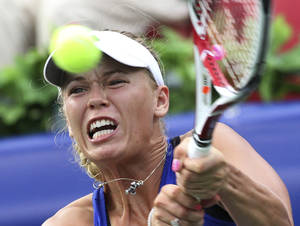 Photo -   Caroline Wozniacki of Denmark returns a shot against Caroline Garcia of France during the second round match of Korea Open Tennis Championships in Seoul, South Korea, Thursday, Sept. 20, 2012. Wozniacki won the match 6-2, 6-3. (AP Photo/Ahn Young-joon)