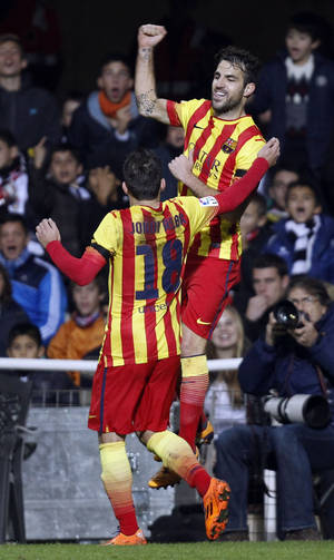 Photo - Barcelona's  Cesc Fabregas, up in air,  celebrates after scoring against Cartagena during their la copa del Rey soccer match at the Cartagonova stadium in Cartagena, Spain, Friday, Dec. 6, 2013. (AP Photo/Alberto Saiz)