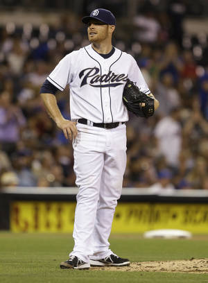 Photo - San Diego Padres starting pitcher Ian Kennedy stands at the front of the pitcher's mound after surrendering a two-run home run to New York Mets' Daniel Murphy and his third home run in four innings in a baseball game, Friday, Aug. 16, 2013, in San Diego. (AP Photo/Lenny Ignelzi)