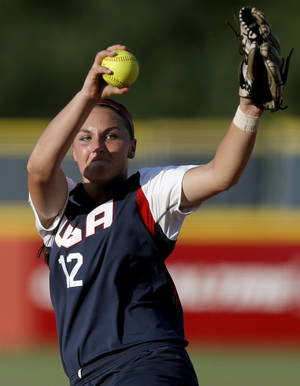 Photo - Jessica Moore of the United States pitches during a World Cup of Softball game between Australia and Team USA at ASA Hall of Fame Stadium in Oklahoma City, Friday, July 12, 2013.  Team USA won 4-0. Photo by Bryan Terry, The Oklahoman