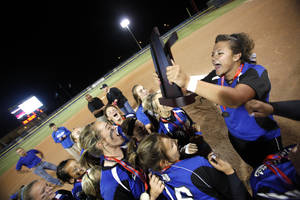 Photo - Little Axe celebrates their win following the 3A state championship softball game between Morris and LIttle Axe at Hall of Fame Stadium, Tuesday, Oct. 11, 2011. Photo by Sarah Phipps, The Oklahoman ORG XMIT: KOD