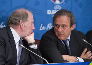 Photo - French President of the Euro 2016 organizing committee Jacques Lambert, left, speaks with UEFA president Michel Platini during a press conference for the presentation of the 2016 European Football Championship in Paris, Friday April 25, 2014. The Euro 2016 championship will run from June 10 to July 10, 2016. (AP Photo/Jacques Brinon)