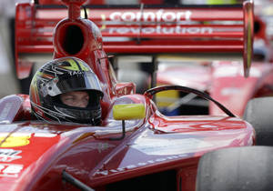 Photo - FILE - In this Oct. 5, 2013, file photo, driver Sage Karam waits for the start of the Indy Lights Grand Prix of Houston auto race in Houston. Karam has made a ton of sacrifices to chase his dream of racing at IndyCar's top level. Now that he's got a ride for the Indianapolis 500, Karam will have to give up another rite of passage: He'll skip his prom to qualify for the biggest race of his career. He had hoped to take girlfriend Ana de Ferran, the daughter of 2003 Indy winner Gil de Ferran. (AP Photo/David J. Phillip, File)