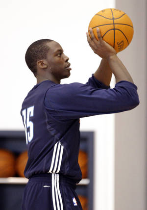 Photo - Oklahoma City's Reggie Jackson shoots during the Thunder's practice in Oklahoma City, Sunday, Dec. 11, 2011. Photo by Sarah Phipps, The Oklahoman