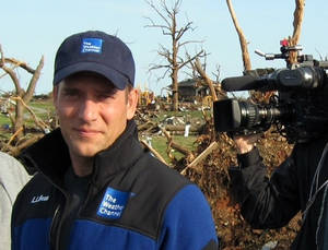 "Photo - This 2011 image released by the Weather Channel shows meteorologist Mike Bettes at the scene of a tornado in Joplin, Mo. Bettes will hit the road starting Monday for ""Tornado Week,"" his network's version of ""Shark Week"" that's usually its biggest scheduled programming event of the year. ""Tornado Week"" will include a special about chasers caught up in the tornado in El Reno, Okla. A new series, ""Tornado Alley,"" will premiere with storm footage, survivor tales and computer graphics to simulate actions of certain tornadoes. (AP Photo/Weather Channel)"