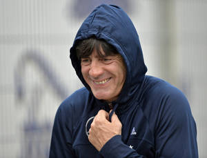 Photo - Germany's head coach Joachim Loew arrives at a training session of the German national team in Duesseldorf, Germany, Tuesday, Oct. 8, 2013. Germany will play their 2014 World Cup Group C  qualifying soccer match against Ireland on Friday in Cologne. (AP Photo/Martin Meissner)