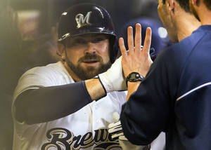 Photo - Milwaukee Brewers' Sean Halton, left, is greeted in the dugout by teammates after hitting a grand slam during the first inning of a baseball game against the Chicago Cubs, Wednesday, Sept. 18, 2013, in Milwaukee. (AP Photo/Tom Lynn)