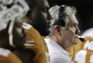 Photo - Texas coach Mack Brown, right, watches from the side lines during the second half of an NCAA college football game against Kansas State, Saturday,  Sept. 21, 2013, in Austin, Texas. (AP Photo/Eric Gay)