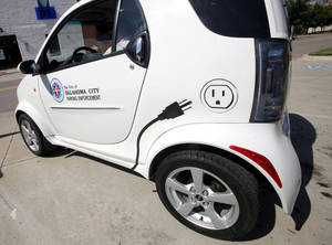 photo - Right: Logos are shown Wednesday on the side of an Oklahoma City Police Department electric vehicle. Photos by Paul B. Southerland, The Oklahoman