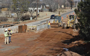 photo - One lane of traffic is open on Bryant Avenue just north of 15th Avenue in Edmond.