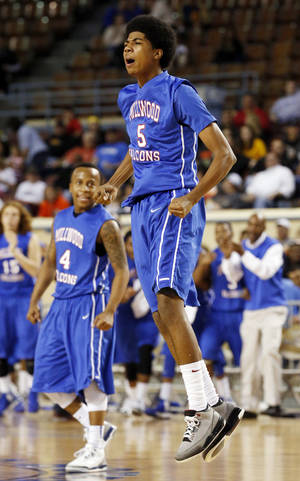 Photo - Millwood's Ashford Golden reacts to a basket during the 3A boys semifinal game between the Millwood High School Falcons and the Centennial Bison at the State Fair Arena on Friday, March 8, 2013 in Oklahoma City, Okla.  Photo by Steve Sisney, The Oklahoman