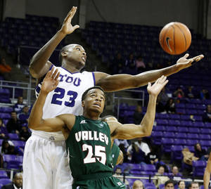Photo - TCU's Devonta Abron (23) grabs a rebound away from Mississippi Valley State's Blake Rolling (25) during their NCAA college basketball game, Sunday, Dec. 30, 2012, in Fort Worth, Texas. TCU won 67-64. (AP Photo/The Fort Worth Star-Telegram, Sharon Ellman)  MAGS OUT; (FORT WORTH WEEKLY, 360 WEST); INTERNET OUT