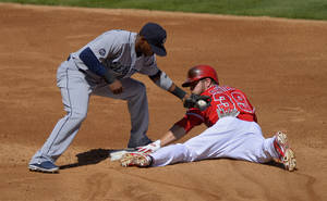 Photo - Los Angeles Angels' J.B. Shuck, right, steals second under the tag of Seattle Mariners second baseman Carlos Triunfel during the third inning of a baseball game on Sunday, Sept. 22, 2013, in Anaheim, Calif. (AP Photo/Mark J. Terrill)